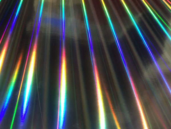 Rainbow holographic film laminated paper